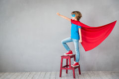 Child pretend to be superhero. Superhero kid. Success, creative and imagination concept Stock Image