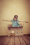 Child is pretending to be a pilot Royalty Free Stock Images