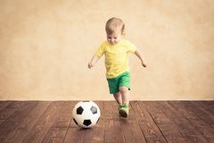 Child is pretending to be a soccer player. Success and winner concept stock image