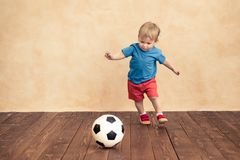 Child is pretending to be a soccer player. Success and winner concept stock images