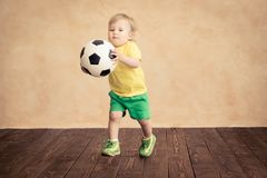 Child is pretending to be a soccer player Royalty Free Stock Image