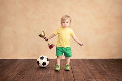 Child is pretending to be a soccer player Royalty Free Stock Images