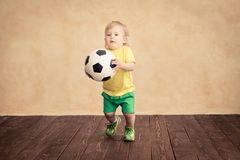 Child is pretending to be a soccer player. Success and winner concept stock photography