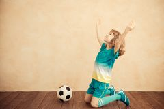 Child is pretending to be a soccer player. Success and winner concept stock photos