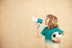 Child is pretending to be a soccer player. Success and winner concept royalty free stock images