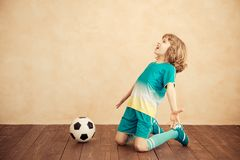 Child is pretending to be a soccer player. Success and winner concept royalty free stock photo