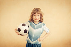 Child is pretending to be a soccer player Stock Photography