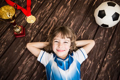 Child is pretending to be a soccer player Stock Image