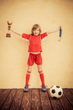 Child is pretending to be a soccer player Royalty Free Stock Photos