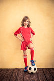 Child is pretending to be a soccer player Stock Photos