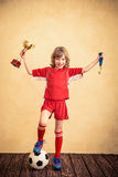 Child is pretending to be a soccer player Stock Photo