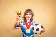 Child is pretending to be a soccer player Stock Images