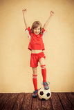 Child is pretending to be a soccer player. Success and winner concept royalty free stock photography