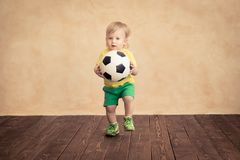 Child is pretending to be a soccer player. Success and winner concept royalty free stock photos