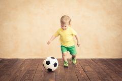 Child is pretending to be a soccer player. Success and winner concept royalty free stock image