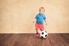 Child is pretending to be a soccer player. Success and winner concept stock photo