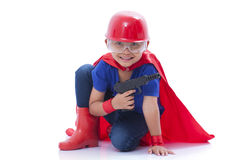 Child pretending to be a superhero with toy gun Royalty Free Stock Photos
