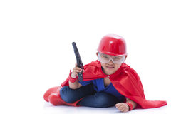 Child pretending to be a superhero with toy gun. On white background Royalty Free Stock Photography