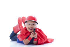 Child pretending to be a superhero with toy gun Stock Photography