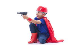Child pretending to be a superhero with toy gun. On white background Stock Image