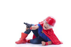 Child pretending to be a superhero with toy gun. On white background Royalty Free Stock Photo