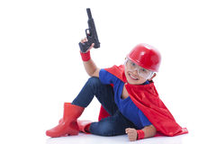 Child pretending to be a superhero with toy gun Stock Images
