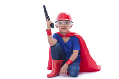 Child pretending to be a superhero with toy gun Stock Photo
