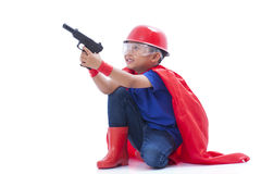 Child pretending to be a superhero with toy gun Stock Photos