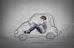 Child pretending to drive a drawn car. Child having fun pretending to drive adrawn car Royalty Free Stock Photography