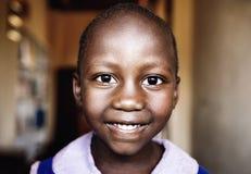 Child in school in Uganda royalty free stock image