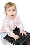 Child printing on laptop Stock Images