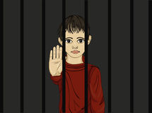 The child in prison. Children of criminals. Behind bars. Stock Photo