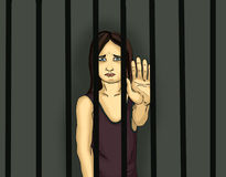 The child in prison. Children of criminals. Behind bars. Juvenile criminals. Angry and unhappy girl showing hand sign enough. Against violence. Stop the Stock Images