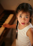 Child profile at piano Stock Photo