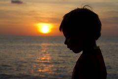 Child profile silhouette at sunset stock photography