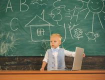 Child programming on laptop in computer class. Developing programming and coding technologies in school.  stock image