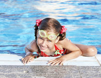 Child with protective goggles  in swimming pool. Stock Images