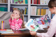 Child psychologist discusses drawing a little girl Stock Image