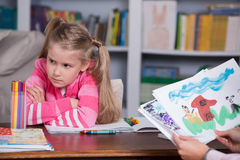 Child psychologist discusses drawing a little girl Stock Photos