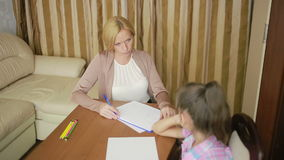 Child psychologist with a little girl. children's psychological counseling. Child psychologist with a little girl stock footage