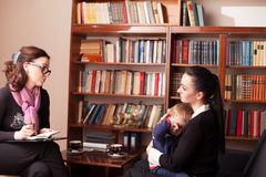 Child psychologist the mother with child Royalty Free Stock Image