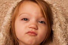 Child puckering blanket royalty free stock photos
