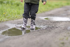 Child in a puddle Royalty Free Stock Images