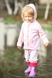 Child in puddle. After summer rain stock images