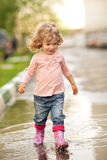 Child in puddle Royalty Free Stock Image