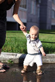 Child and puddle Royalty Free Stock Image