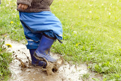 Child in puddle Royalty Free Stock Images