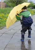 Child in puddle Stock Photo