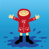 Child and Puddles. A small boy or girl in a red raincoat having fun splashing in the puddles after a shower of rain Royalty Free Stock Photo
