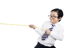 Child pulling a rope. Little child pulling a rope - isolated on white background Royalty Free Stock Images